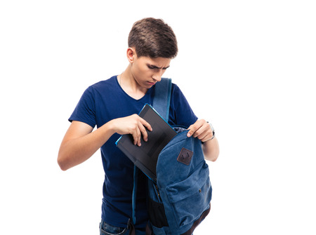 Male student putting folder in backpack isolated on a white background