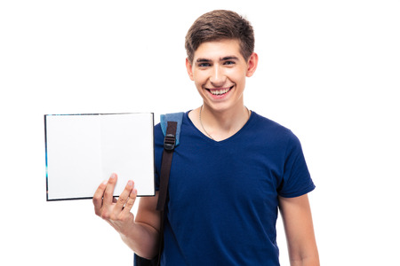 Smiling male student holding blank paper isolated on a white background. Looking at camera photo