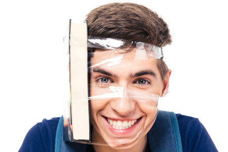strapped: Male student with book strapped to his head isolated on a white background. Looking at camera