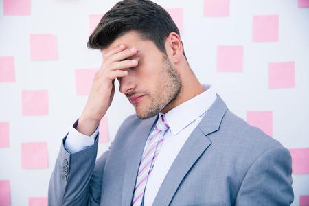 male headache: Businessman having headache in office