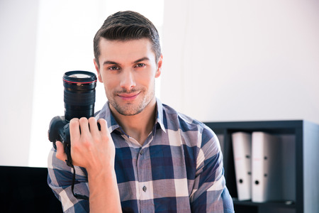 handsome man: Happy young man in shirt holding photo camera