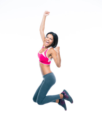armpits: Smiling sporty woman jumping isolated on a white background. Looking at camera