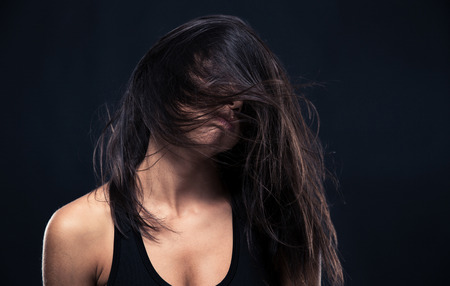 Portrait of exhausted woman over black background Stock Photo