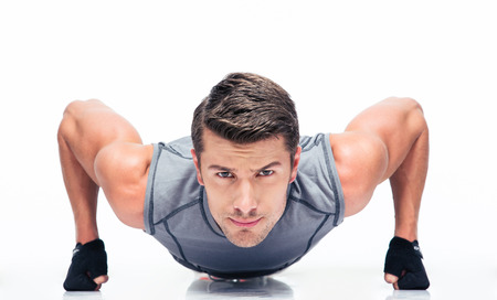 Sports young man doing push ups isolated on a white background