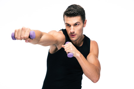 Fitness man working out with small dumbbells isolated on a white background Foto de archivo