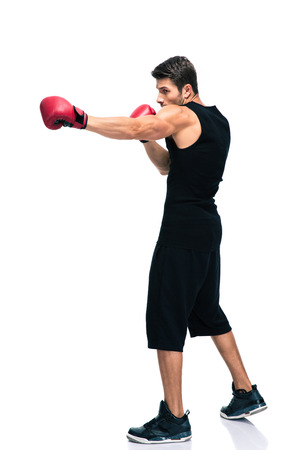 boxing sport: Full length portrait of a sports man boxing in red gloves isolated on a white background Stock Photo