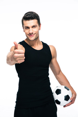 man looking up: Handsome smiling man with soccer ball showing thumb up sign isolated on a white background. Looking at camera