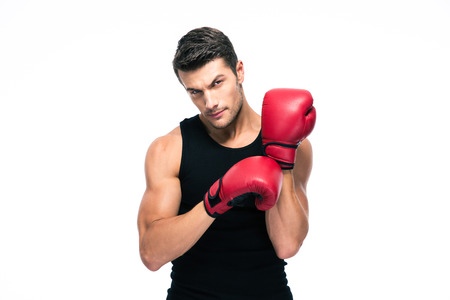 Portrait of a fitness man wearing red boxing gloves isolated on a white background. Looking at camera