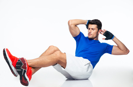 workout gym: Sports man doing abdominal exercises isolated on a white background