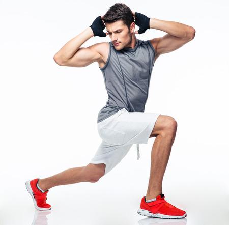 In voller Länge Portrait eines Fitness-Mann streckte auf einem weißen Hintergrund Standard-Bild - 41751526