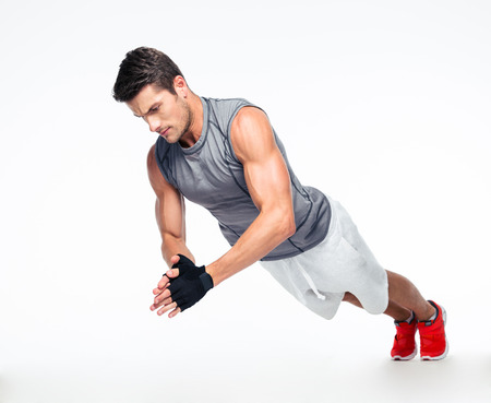 Fitness man doing exercises on the floor isolated on a white background Stock Photo