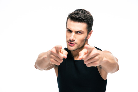 Fitness man pointing fingers at camera isolated on a white background Stockfoto