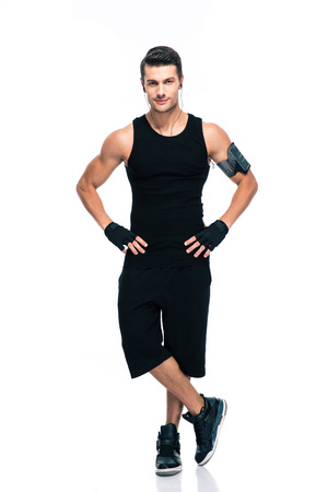 Full length portrait of a confident fitness man standing isolated on a white background. Looking at camera Stock Photo