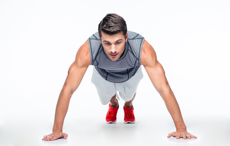 macho man: Fitness man doing push ups isolated on a white background