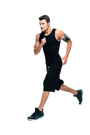 sportswear: Full length portrait of a handsome sports man running isolated on a white background