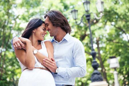 date tree: Happy beautiful couple having fun outdoors in park Stock Photo