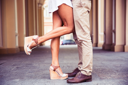 dress shoe: Closeup portrait of a Male and female legs during a date