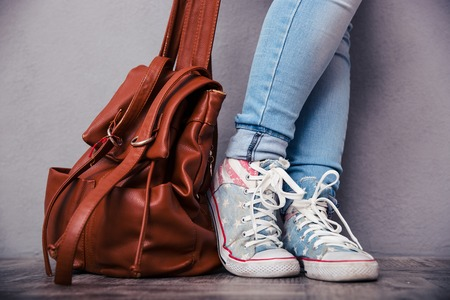 fashion bag: Closeup portrait of female legs with leather backpack