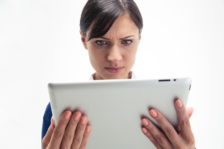 computer isolated: Businesswoman using tablet computer isolated on a white background
