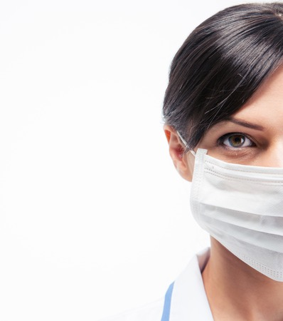facemask: Cropped image of a female medical doctor in mask looking away isolated on a white background