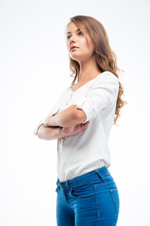 disregard: Serious young woman standing with arms folded isolated on a white background