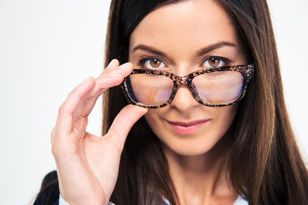 woman wearing glasses: Closeup portrait of a businesswoman holding glasses and looking at camera