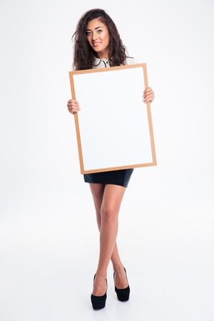 busineswoman: Full length portrait of a cheerful busineswoman holding blank board isolated on a white background