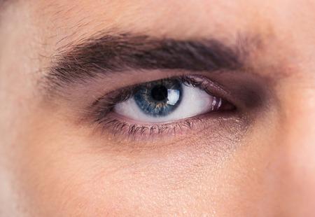 medical eye care: Closeup portrait of male eyes