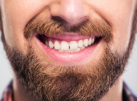 mouth smile: Cropped image of a happy male face