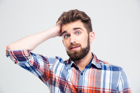 stunned: Portrait of amazed young man looking at camera isolated on a white background