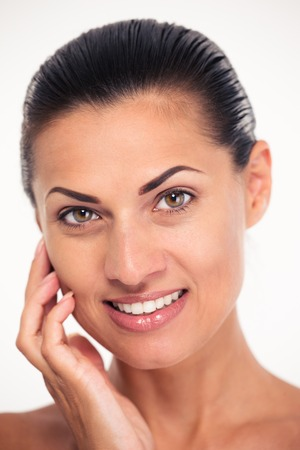 Closeup portrait of a smiling woman with fresh skin looking at camera photo