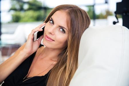 lady hand: Beautiful elegant woman in black dress talking on the phone Stock Photo