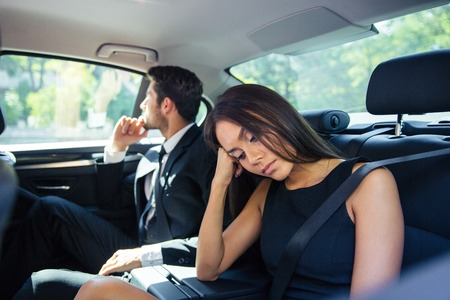 sleep man: Beautiful couple resting on back seat in car