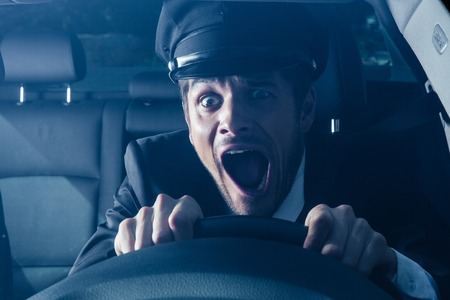 Male chauffeur gets into car crash and makes ridiculous face Stock Photo