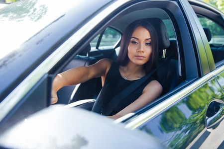 car navigation: Beautiful woman driving car