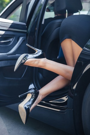 Legs and heels: Closeup portrait of a female legs in car