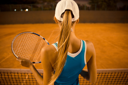 tennis clay: Back view portrait of a woman playing in tennis outdoors