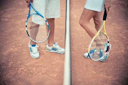 tennis skirt: Closeup portrait of female and male legs at the tennis court