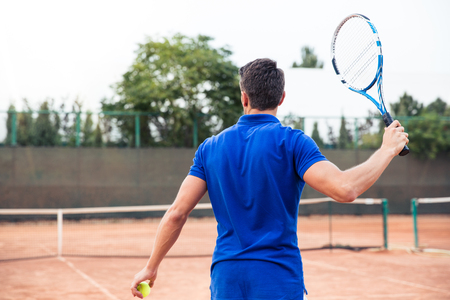 male tennis players: Back view portrait of a man playing in tennis outdoors Stock Photo