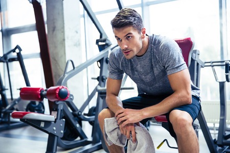 Portrait of a handsome fitness man resting at gym Stock Photo