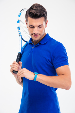 tennis player: Portrait of a handsome male tennis player looking on fitness activity isolated on a white background Stock Photo
