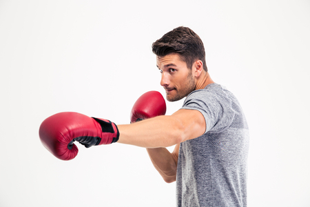 boxing sport: Portrait of a handsome man boxing isolated on a white background