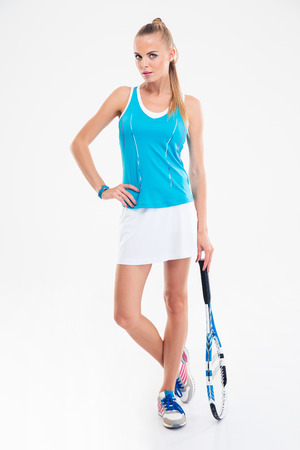 tennis skirt: Full length portrait of a serious female tennis player standing isolated on a white background