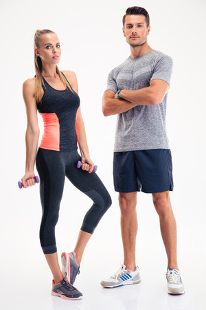 fit man: Portrait of a fitness couple standing isolated on a white background Stock Photo