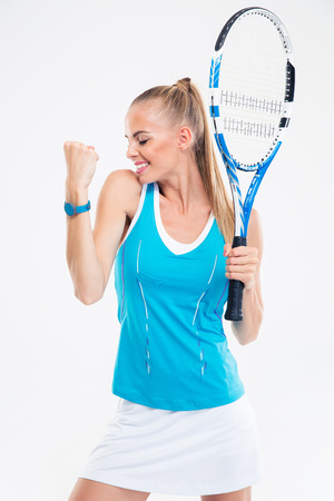 athletic wear: Portrait of a happy female tennis player celebrating her success isolated on a white background