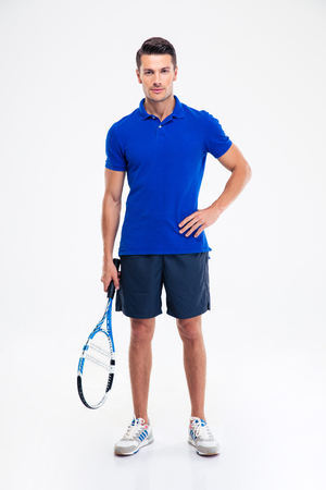 racket: Full length portrait of a handsome sports man standing with tennis racket isolated on a white background Stock Photo