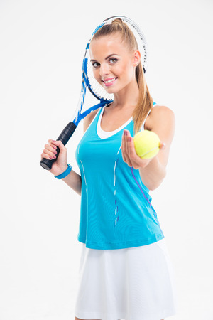 tennis skirt: Portrait of a smiling woman holding tennis player and ball isolated on a white background