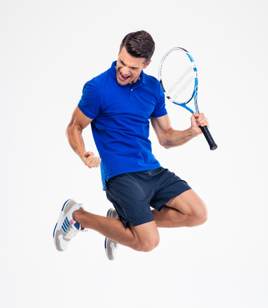 male tennis players: Portrait of a young male tennis player celebrating his success isolated on a white background
