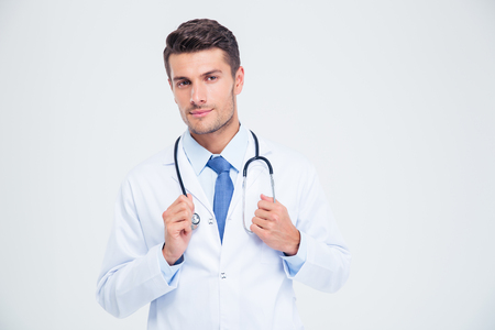 Portrait of a male doctor standing with stethoscope isolated on a white background