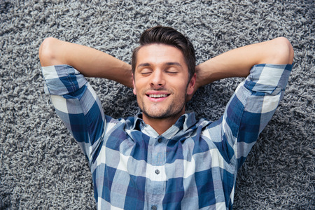 only man: Portrait of a handsome man resting on the floor at home